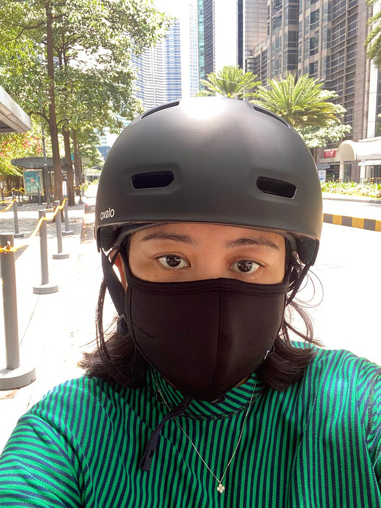 A mask, helmet, and a vivid shirt are necessary bike accessories so motorists can see you from afar