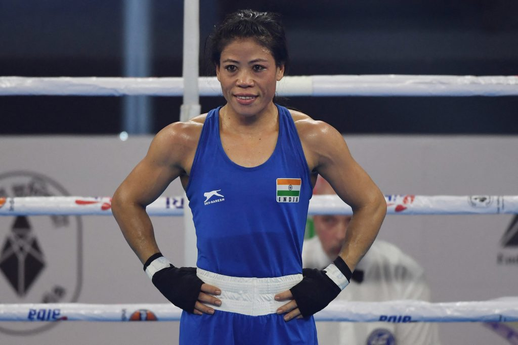 Mary Kom of India reacts after winning the match against Kim Hyang Mi of North Korea during their 45-48 kg category semifinal at the 2018 AIBA Women's World Boxing Championships in New Delhi