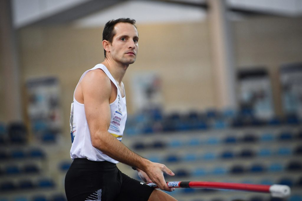 France's Renaud Lavillenie looks on as he competes in the men's pole vault final during the Athletics French Indoor Championships