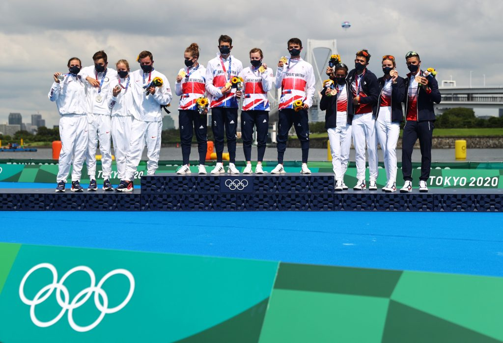 Jonny Brownlee stands proud with Team Britain alongside silver medalists Team USA and bronze medalists Team France