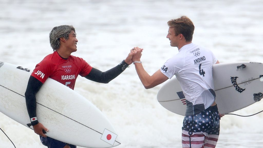 Surfing quarterfinal action: Kanoa Igarashi of Japan shakes hands with Kolohe Andino of the United States after competing in Heat 1