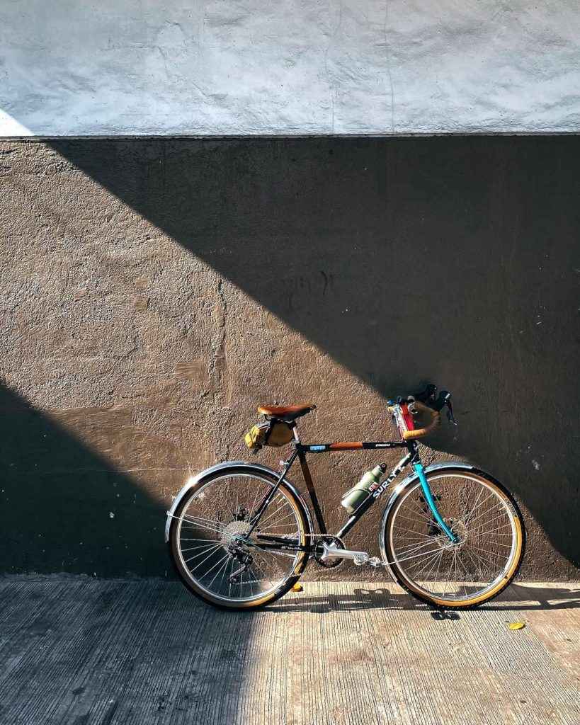 Jilson Tiu's transport of choice: the Surly Straggler awash in light as seen on his cycling Instagram